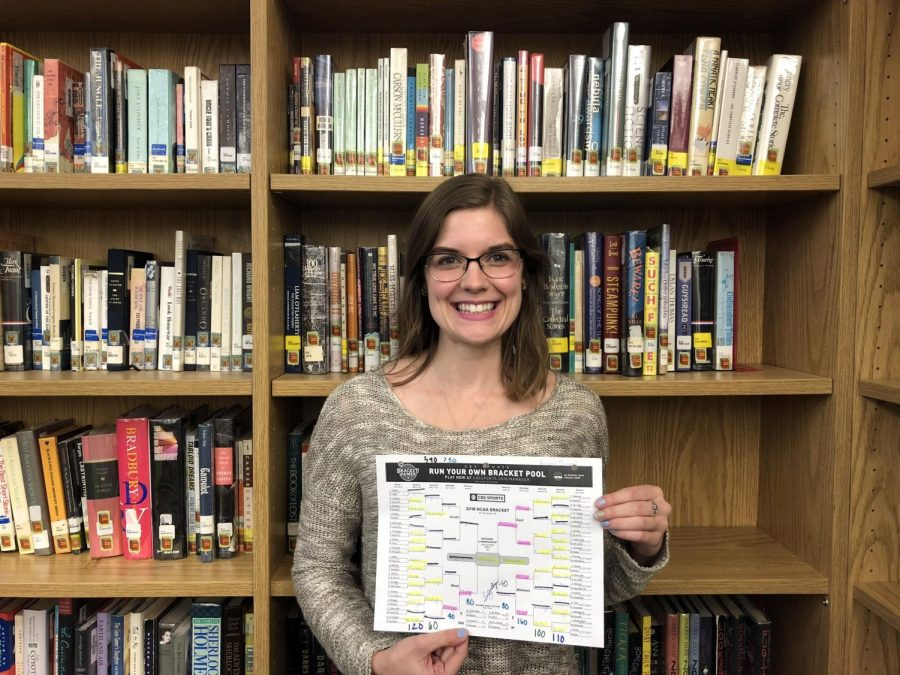 Library assistant Amber Smeal conferred with her younger brother, a basketball lover, to complete the winning bracket.
