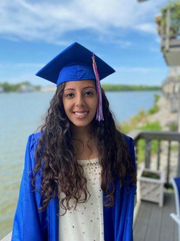 Class of 2020 valedictorian Sama Kubba poses in her cap and gown